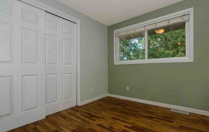 Furnished bedroom in two story friendly house.