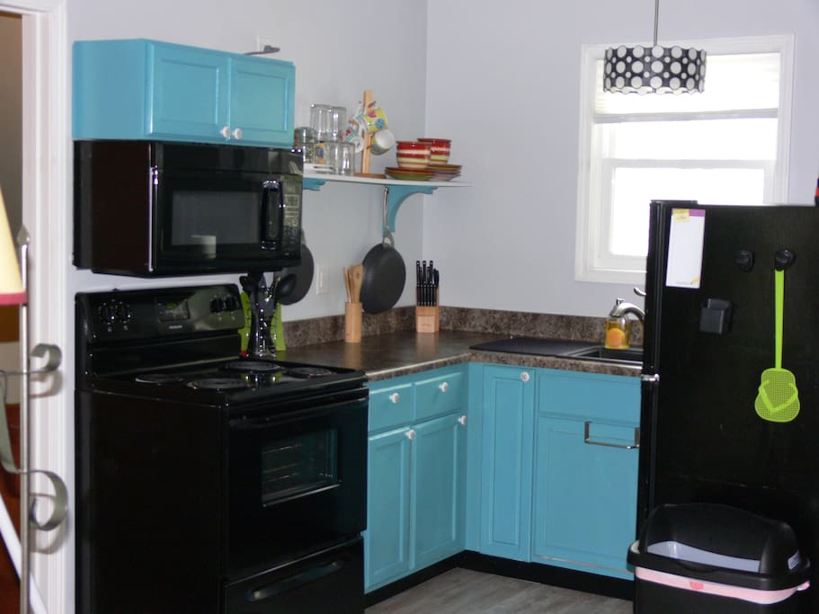 Full kitchen has microwave, range, and frig. Furnished with dishes, pans, utensils, etc.