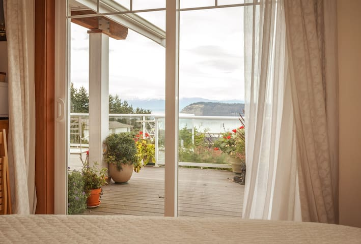 The view to Puget Sound and the water's edge from Master bedroom