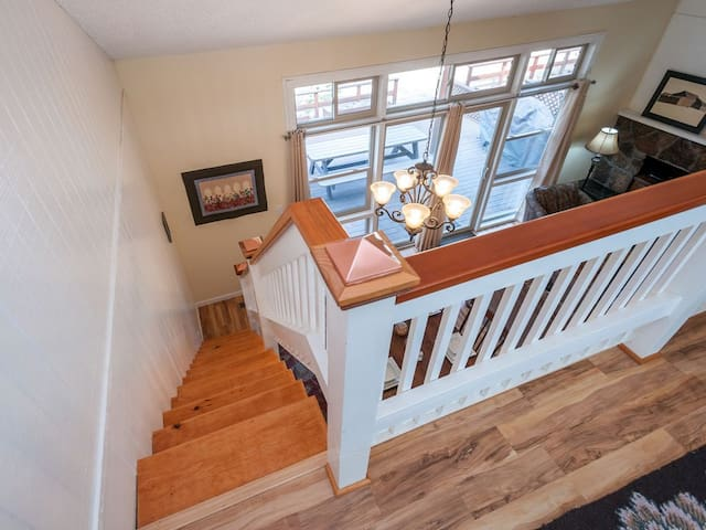 stairway to loft with two twin beds