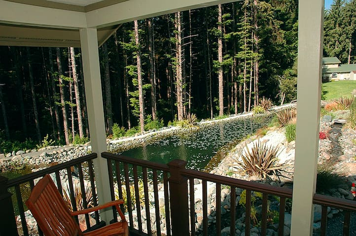 Relax in the rocking chairs on the covered porch. Hear the water coursing down the tributaries of the Tranquility Pond.