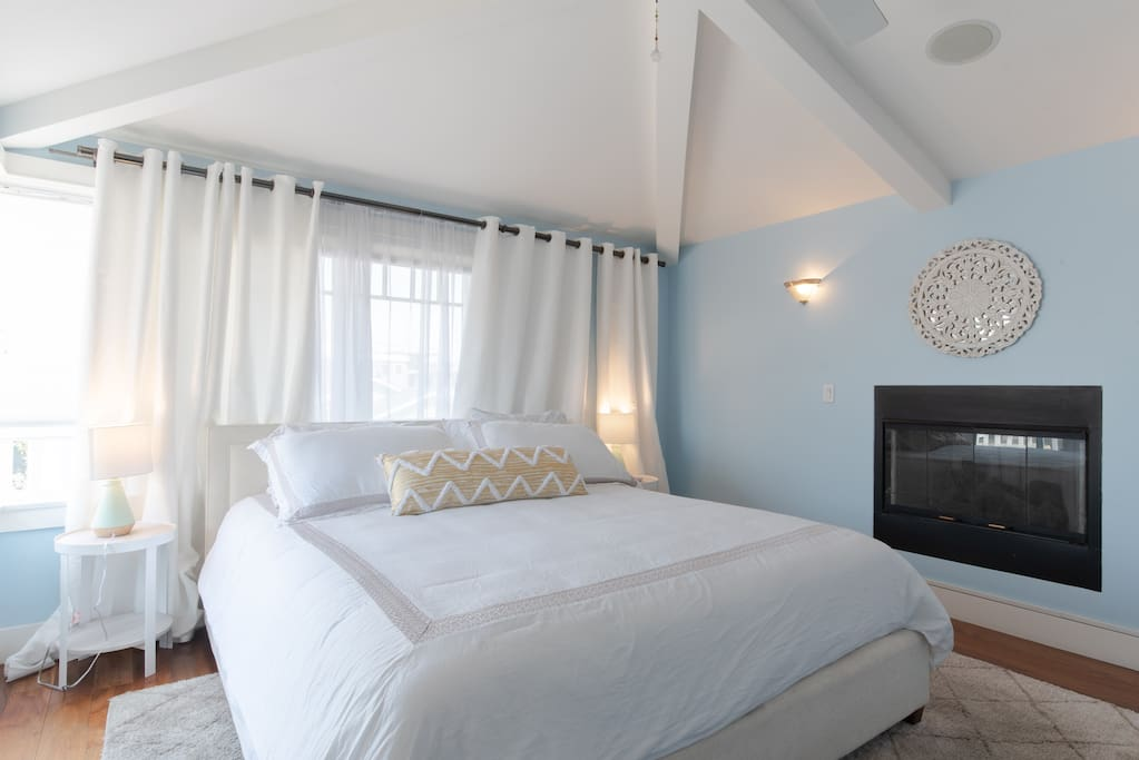 MASTER BEDROOM WITH FIREPLACE AND PRIVATE BALCONY WITH SEATING AREA
