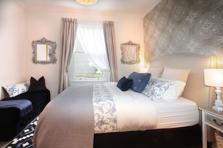 Bedroom two at Fox's Retreat is positioned opposite the main bathroom.