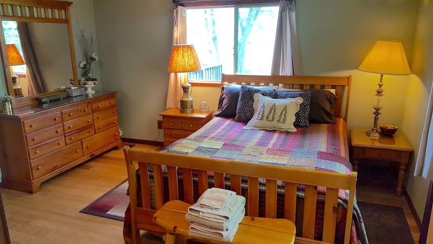Master Bedroom with Full Bathroom & Private Deck Facing Creek