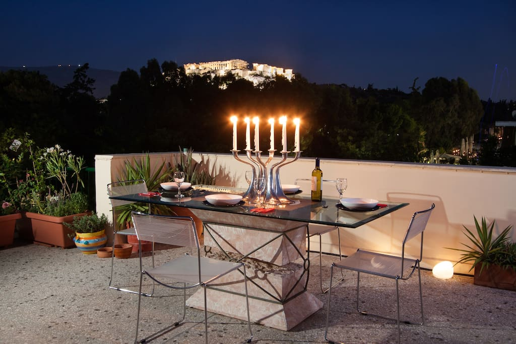 Dining table in roof garden with Acropolis view