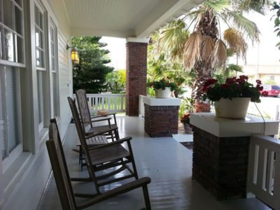 Gather outside on the front porch and enjoy the ocean breeze & sound of the gulf