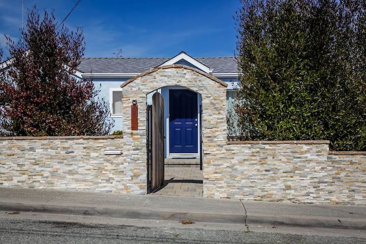 Our stone wall and archway opens into our front yard.