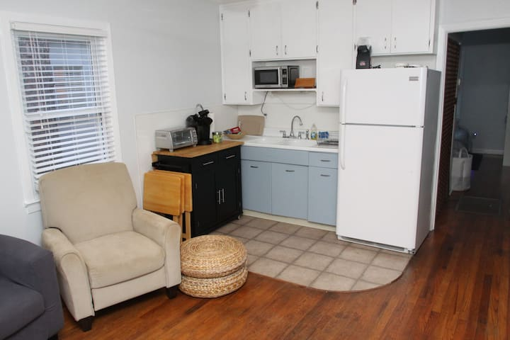 This small kitchenette is packed with everything you need: Keurig coffee maker (plus coffee and fixing's), microwave, toaster oven, full refrigerator, an air popcorn maker (popcorn included), and full set of plates/utensils/glasses/mugs.