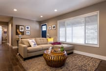 There is plenty of seating in the living room to enjoy the HDTV or the gas fireplace.