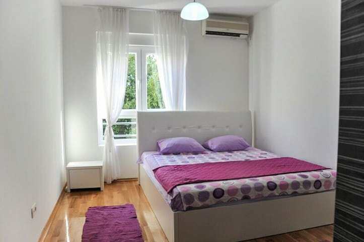 Bedroom with natural lighting a spacious bed