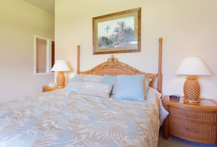 The master bedroom features a king sized bed and small private lanai