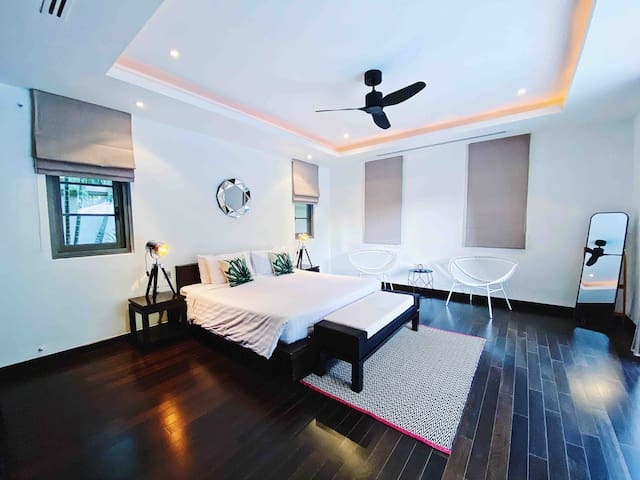Pool view master bedroom with private entrance and ensuite bathroom