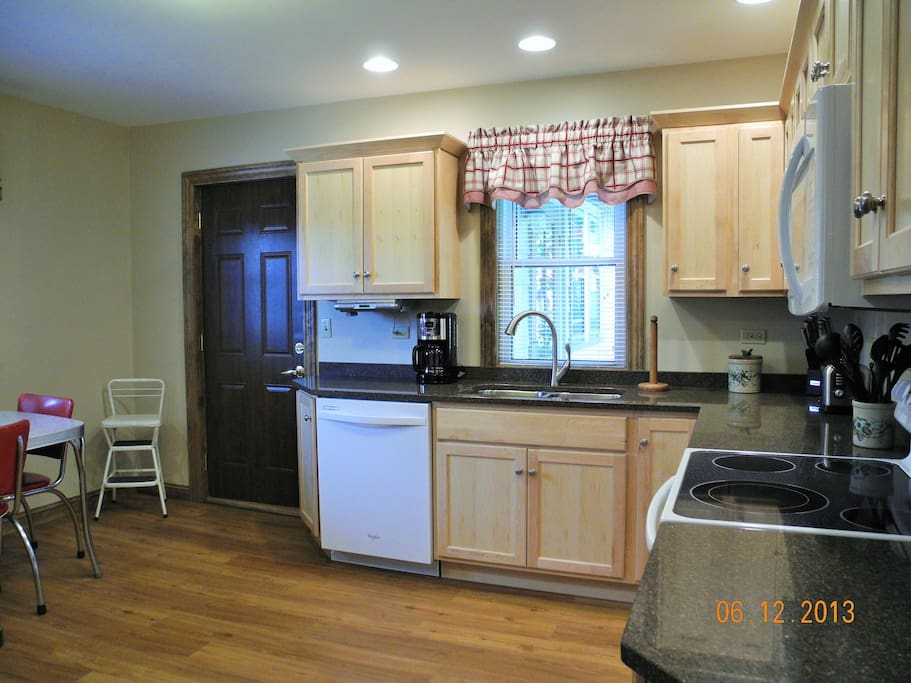 Large kitchen, includes dishwasher, table & 4 chairs.