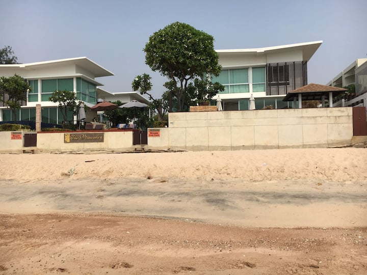 Seafront villa by beach