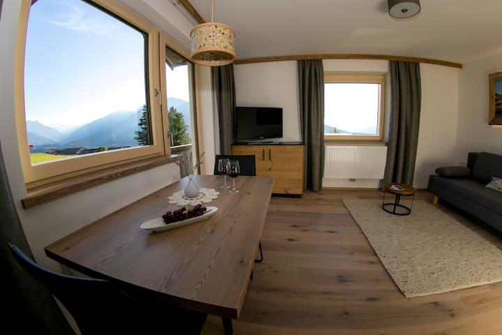 Modern alpine chalet, mountain panorama Stubai