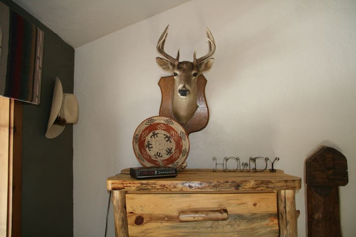custom hand-crafted dresser guarded by Rudolph in master bedroom