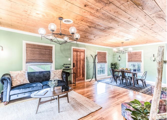 """Cozy living room, dining room combination with fireplace and 50"""" TV."""