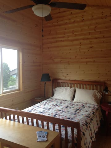 Queen bed in new guest room.