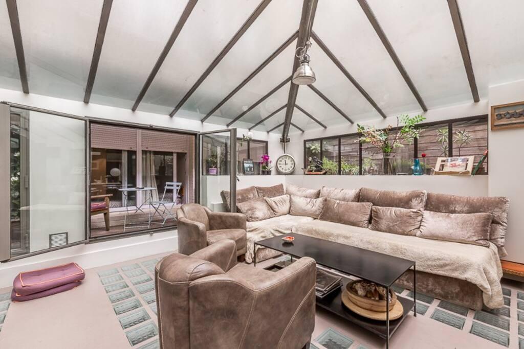 Confortable living-room in a spacious veranda