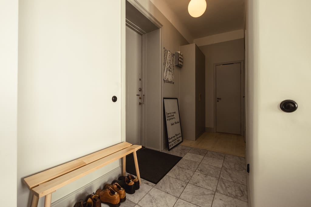 Hallway with storage and bench
