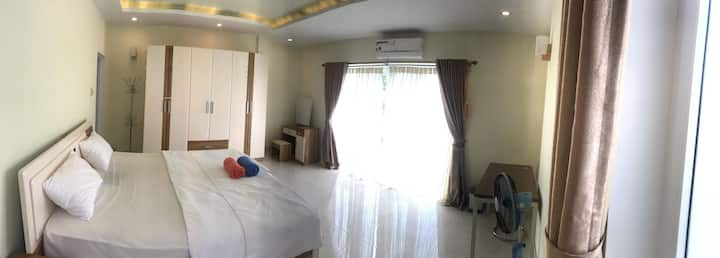Large room with king size bed and soft mattress!