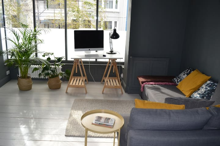 Living space with iMac for guest use