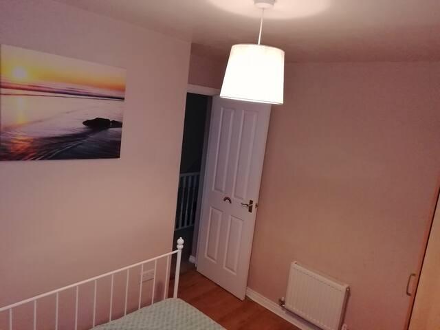 Bedroom:  view towards the corridor.