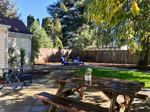 Private yard with bbq grill and fire pit