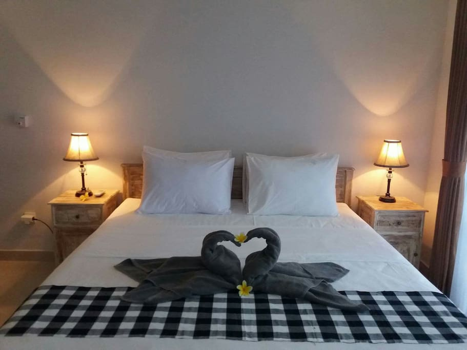 A confortable room with double bed and 2side table
