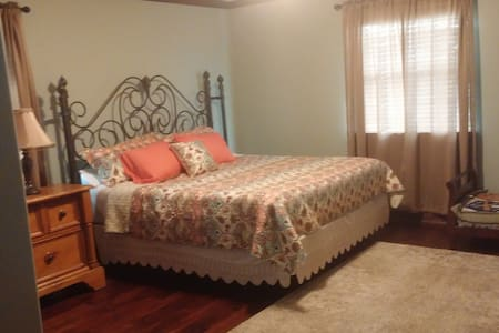 King Size bed in large room. - Sealy