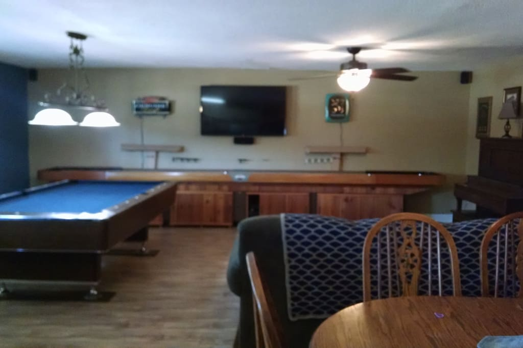 Game room with surround tv and shuffle board