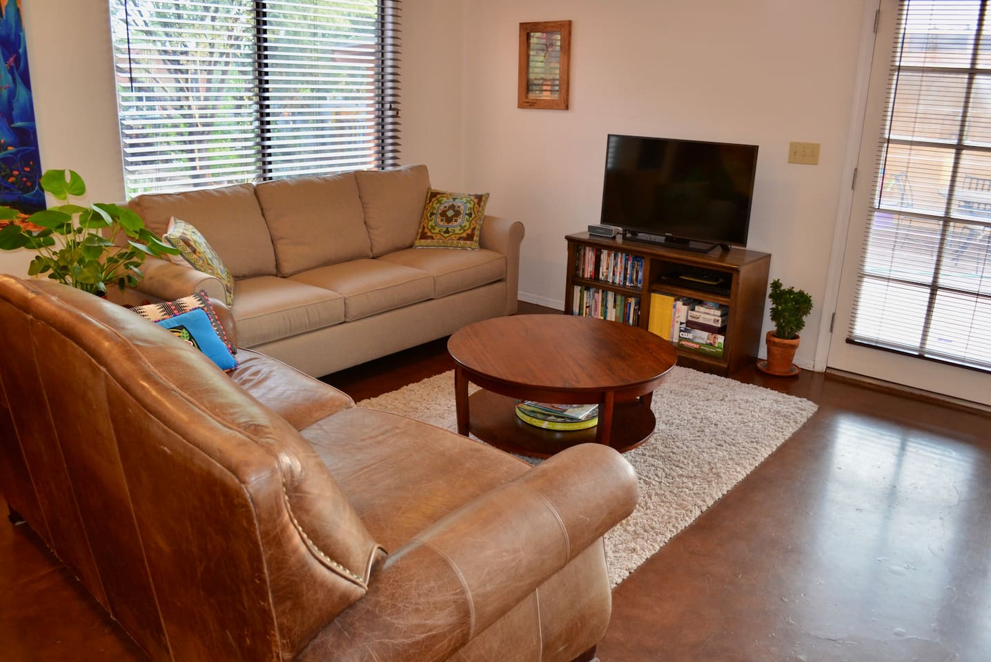 """The living room has a 40"""" TV with Netflix and a new queen sleeper sofa. Stocked with movies, books, games and puzzles."""