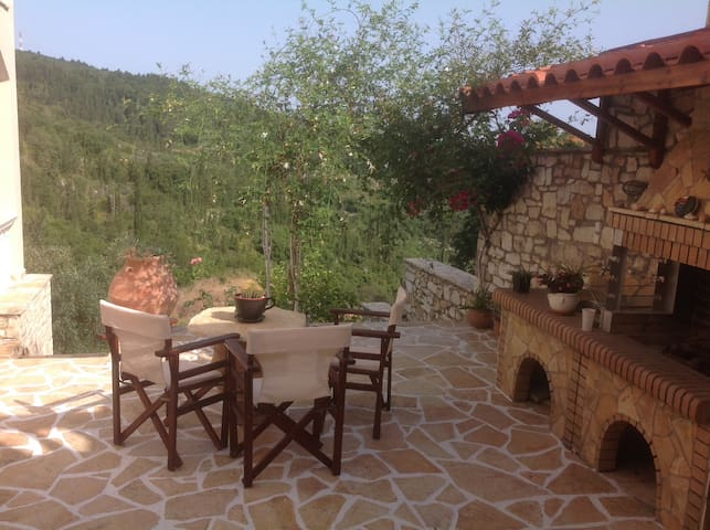 Relax over looking the valley and relax with a drink of your choice