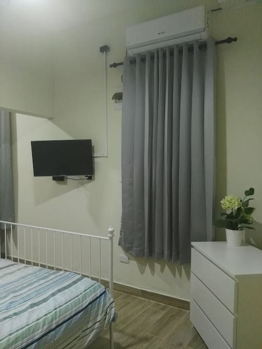 Bedroom equipped with air conditioner