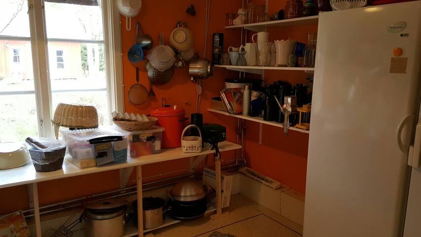 Walk-in pantry. Large fridge and freezer