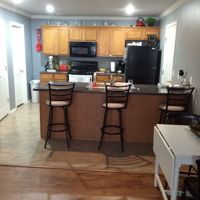 Kitchen fully stocked with appliances and dishes.  Kitchen also has snacks and drinks available for guests.