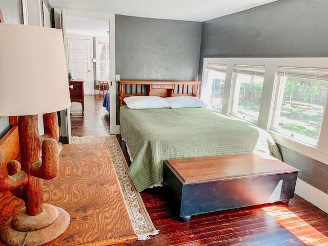 West Room - queen bed, dresser, closet and reading chair.
