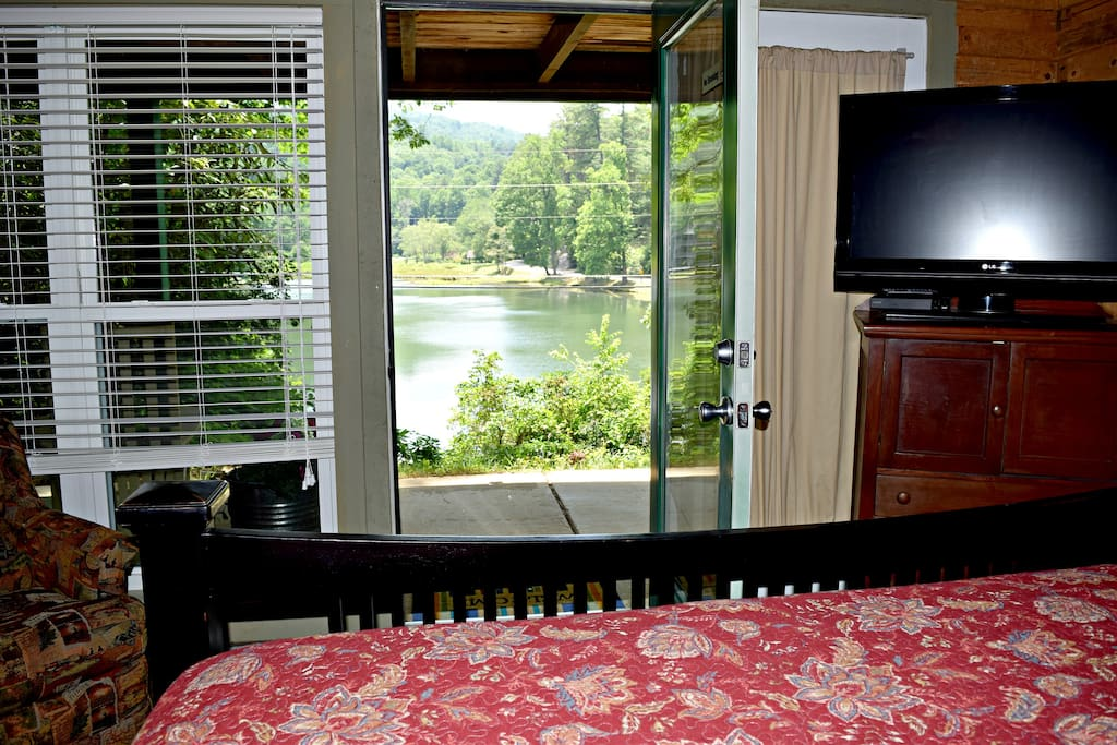 You'll enjoy staying in the master bedroom with this view of the lake and the sound of water rushing over the slipway.