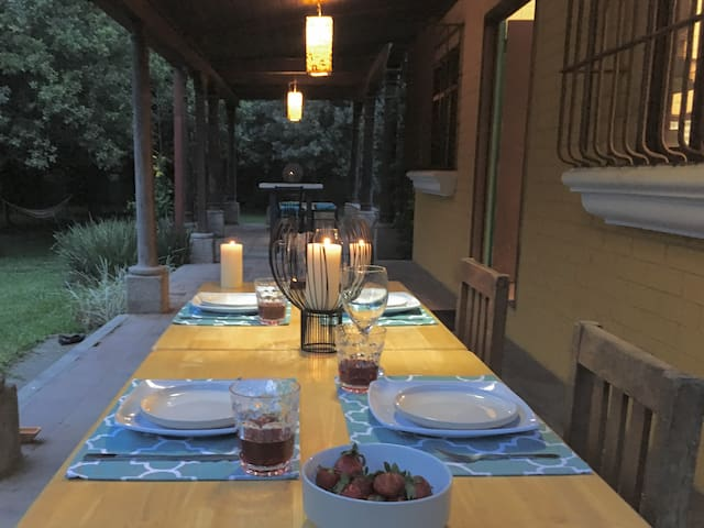 I set your table for dinner at sunset.  Lanterns of handmade paper--a specialty of Antigua--hang from the pergola.