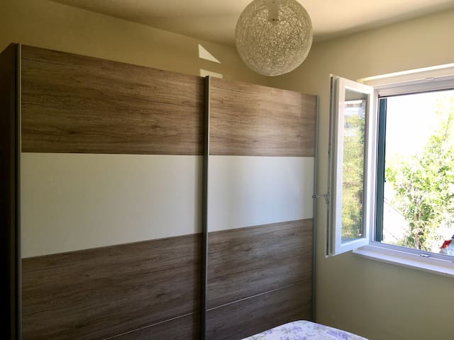 A large wardrobe in the first  bedroom where you can put your things and find additional cushions and bed sheets.