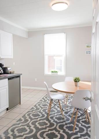 Work or dine at our light, spacious, and well equipped kitchen area