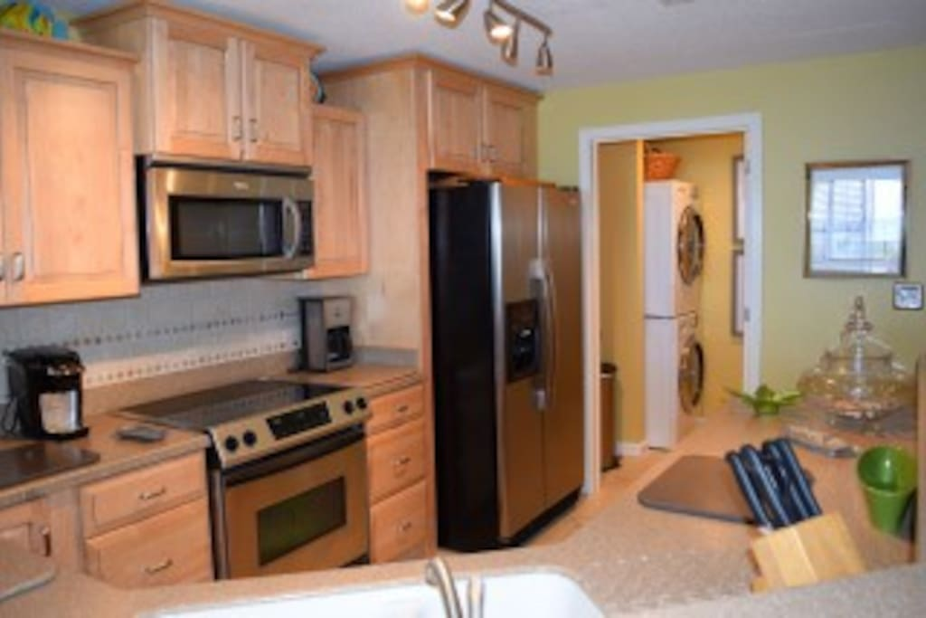 Renovated, fully-equipped kitchen with stainless appliances overlooking the Gulf