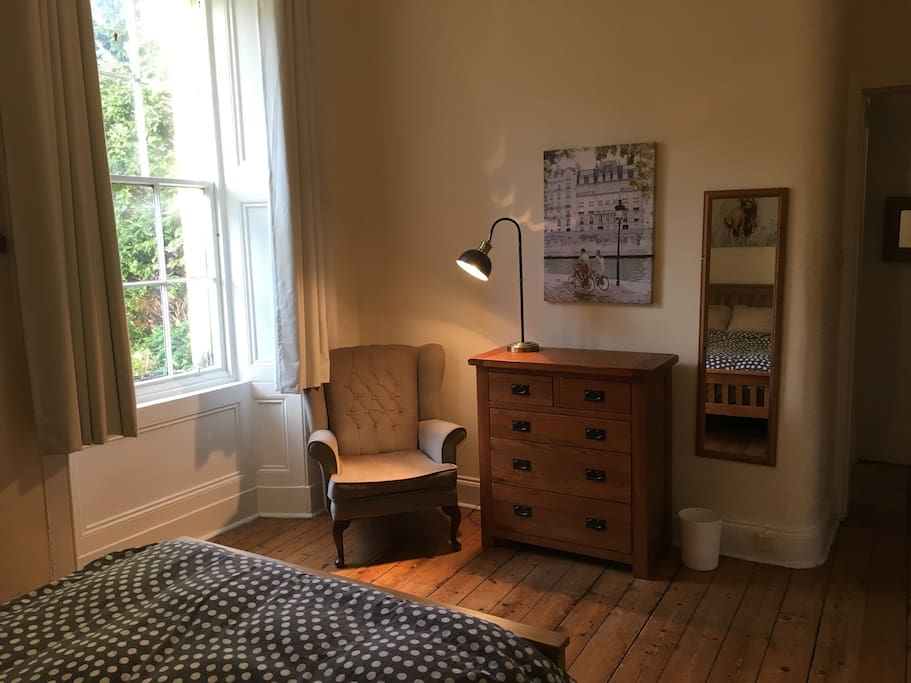 Spacious private room includes drawers and a reading chair