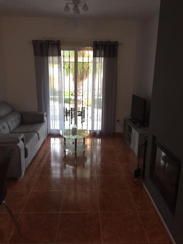 """Lounge with new 40"""" Smart TV with  Over 130 stations, leading to conservatory area"""