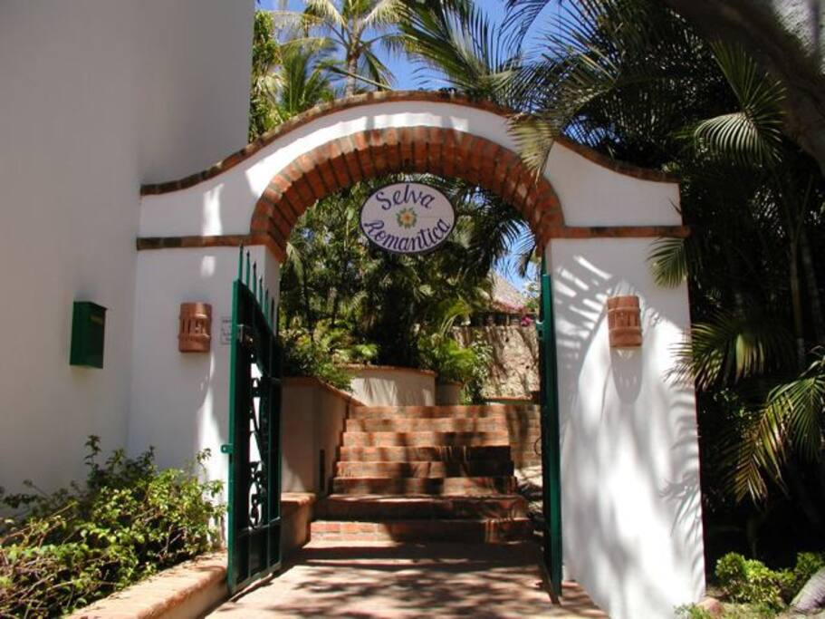 Casa Loma is located in gated Selva Romantica with lush landscaping.