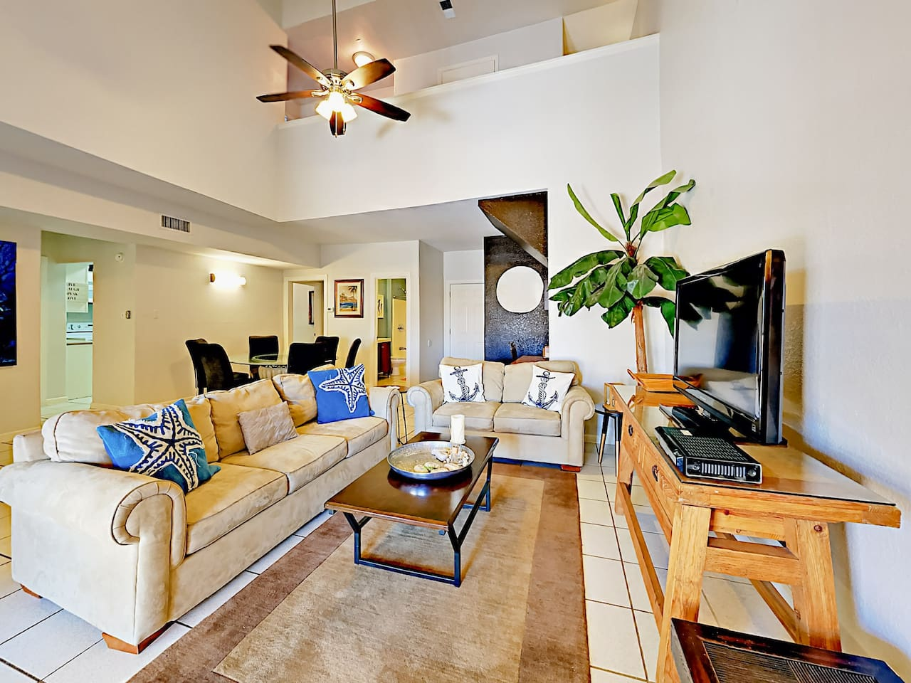 """Welcome to South Padre Island! A spacious sleeper sofa and love seat face a 40"""" flat screen TV in the living room."""