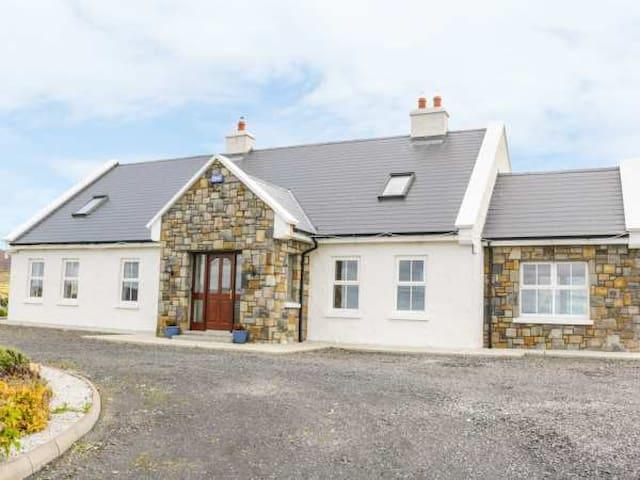 McGuire's Cottage overlooking Broadhaven Bay