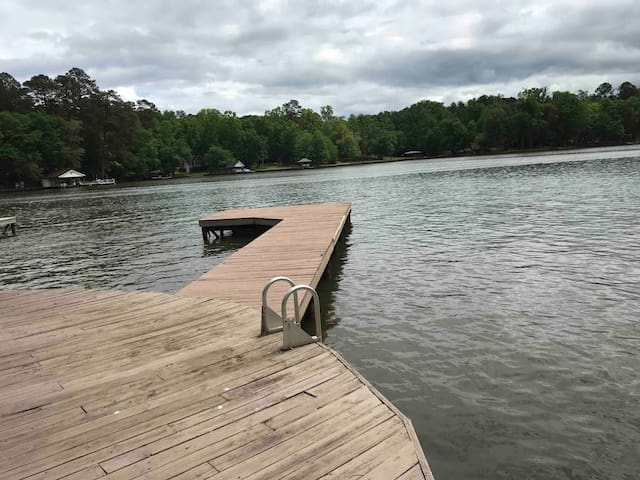 Water levels increase during the day due to the dam. Water is 6-7' deep at the end of the dock, 4-5' deep at the boat cleats and 3-4' deep at the ladder into the water. Cove is 18-20' deep. Reverse boat to leave the dock into the 6+ feet water.
