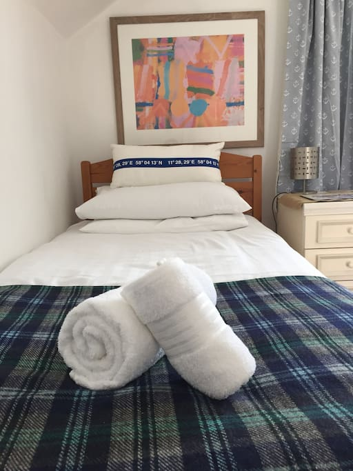 Beds with fresh linen & towels.