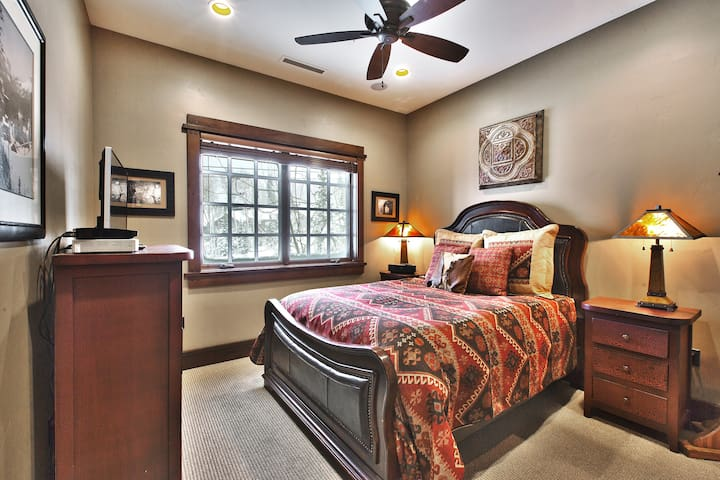 Middle bedroom has comfortable queen bed, private bath with steam shower.
